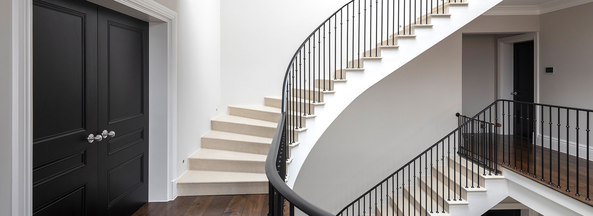 Stone staircase with wrought iron balustrade