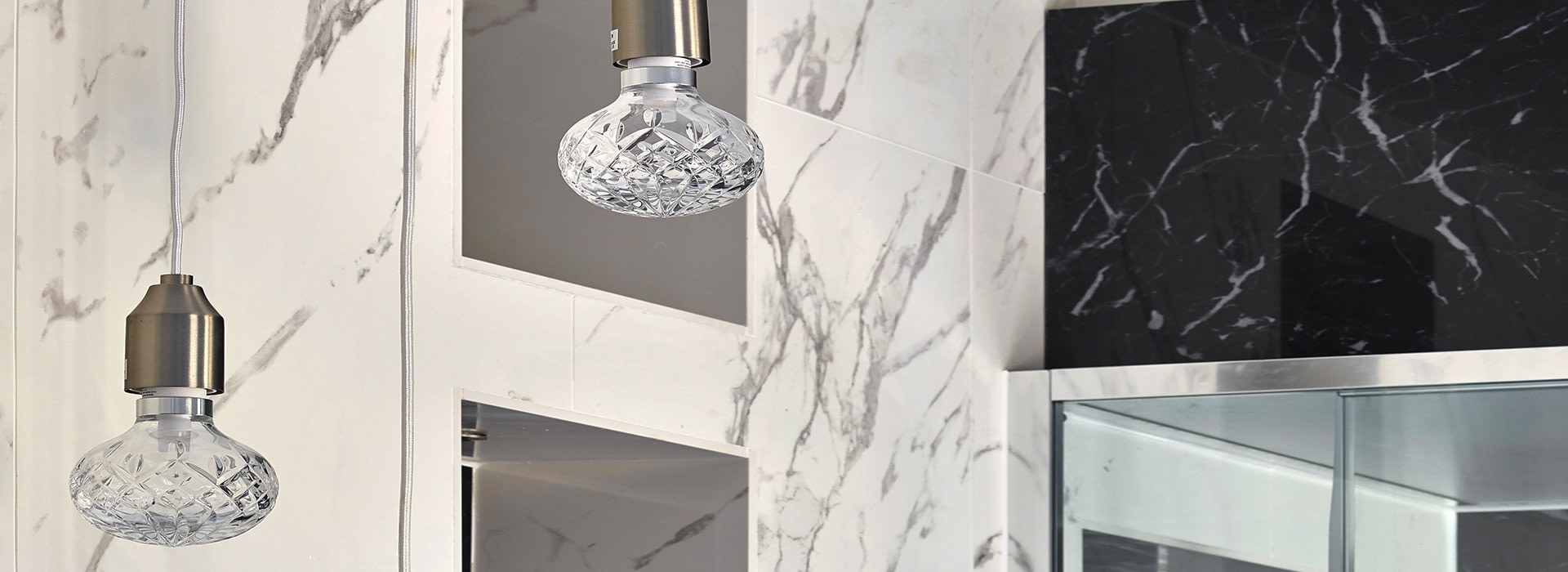 Crystal cut light bulbs with black and white marble tiles