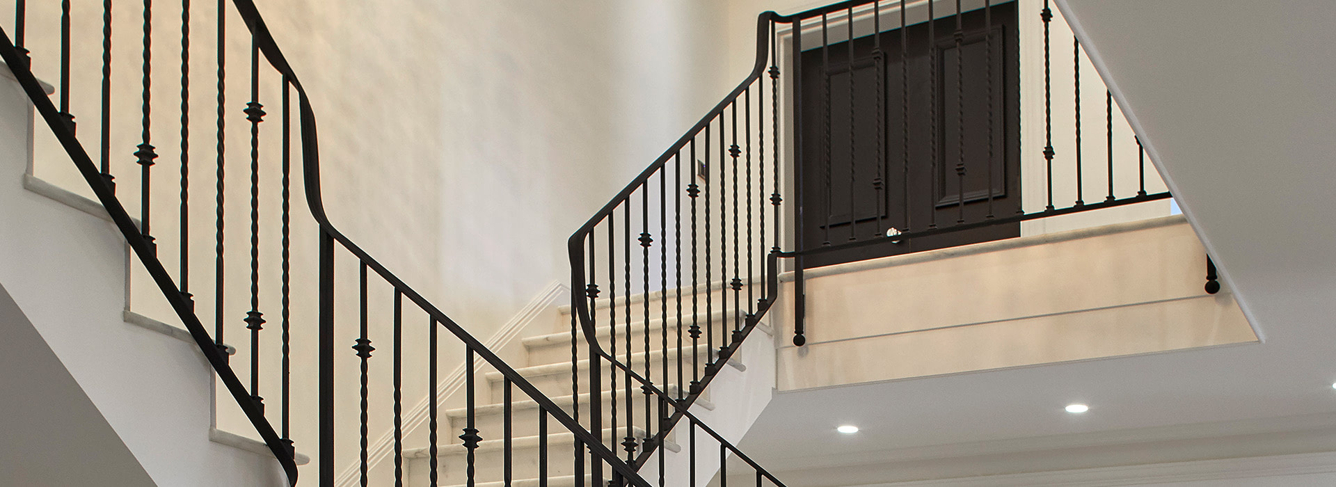 Marble staircase with crystal beaded chandelier