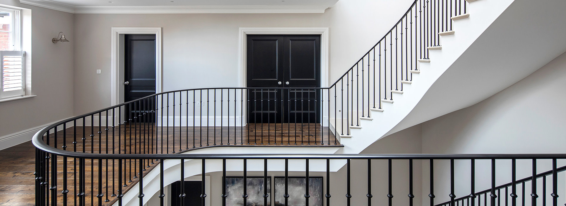Wrought iron staircase with Knightsbridge interior doors