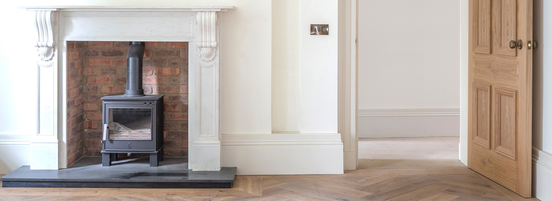 Log burning stove in a traditional home