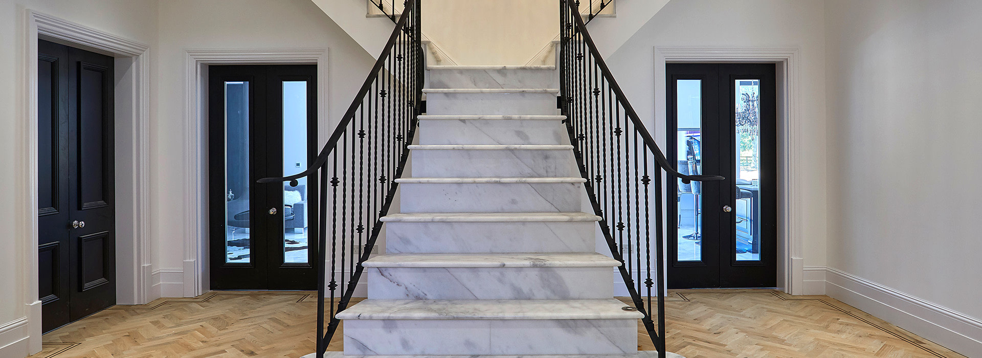 Marble staircase with oak parquet hallway flooring