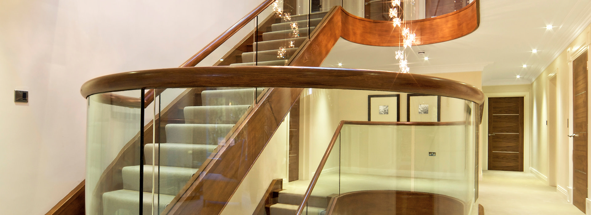 Glass and walnut staircase