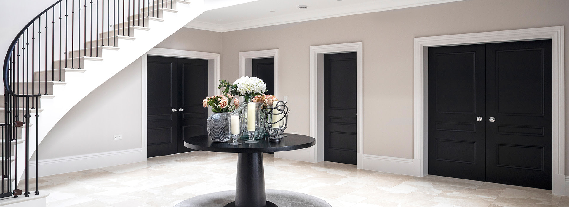 Large round console table in hallway