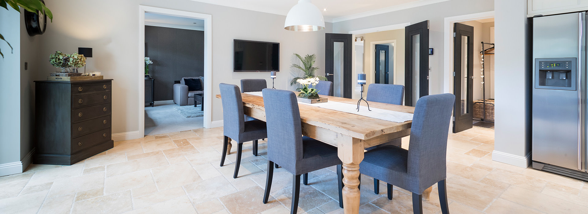 Dining room with natural stone flooring