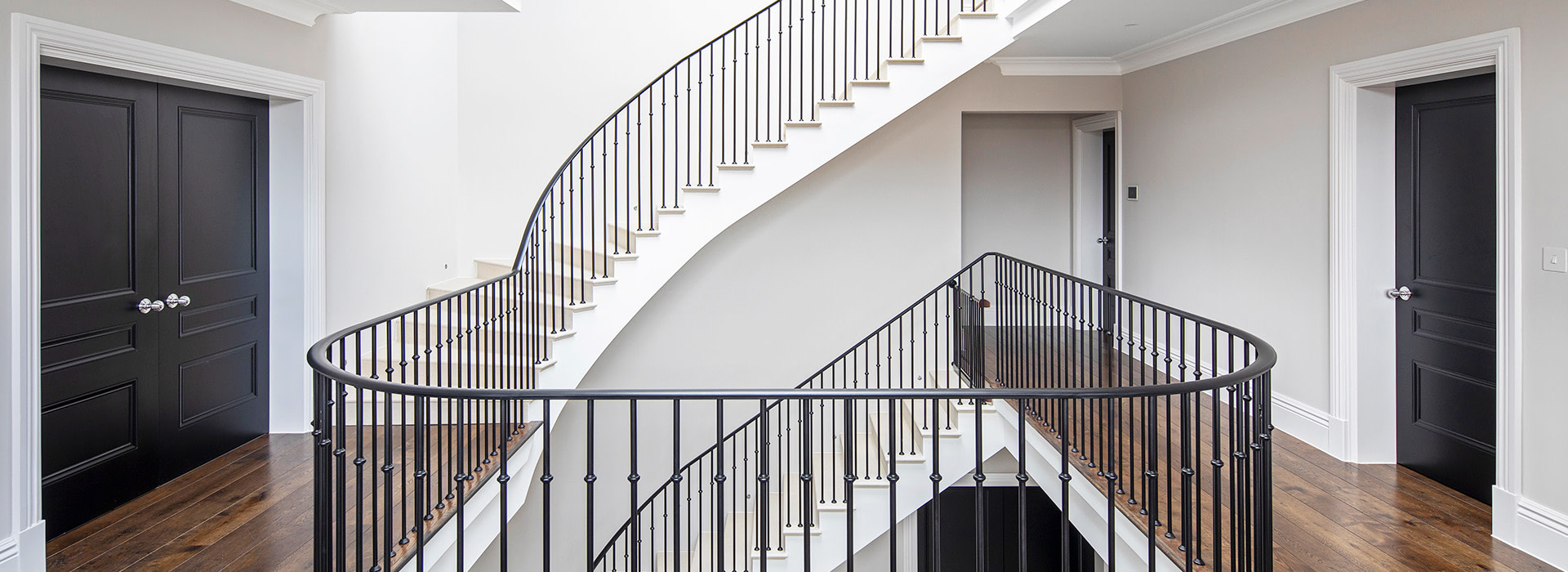 Wrought iron staircase with jet black interior doors